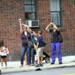 Residents in Pelham Bay were observed pointing their cellphones to the sky during the partial eclipse on August 21.--Photo by David Greene