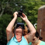 One woman came prepared with a special mask and camera to capture the first New York eclipse since 1979.--Photo by David Greene