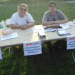 Grace Lovaglio and Larry Mauriello man a table for the District 11, Department of Youth and Community Development Advisory Board, during the annual National Night Out.--Photo courtesy of Grace Lovaglio