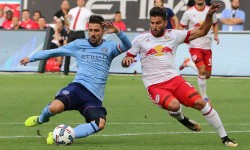 New York City FC forward David Villa (7) shoots the ball as New York Red Bulls midfielder Salvatore Zizzo (15) defends during the first half at Yankee Stadium. Credit: Vincent Carchietta-USA TODAY Sports