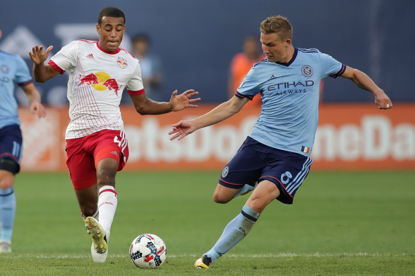 New York, NY, USA; New York City FC midfielder Alexander Ring (8) shoots the ball as New York Red Bulls midfielder Tyler Adams (4) defends during the second half at Yankee Stadium. Credit: Vincent Carchietta-USA TODAY Sports