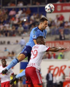 Aug 25, 2017; Harrison, NJ, USA; New York City FC defender RJ Allen (27) heads the ball over New York Red Bulls defender Fidel Escobar (29) during the second half at Red Bull Arena. Mandatory Credit: Brad Penner-USA TODAY Sports