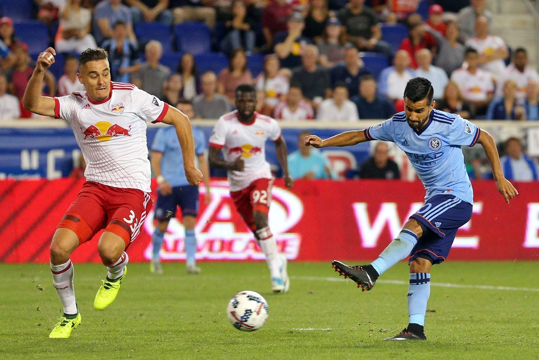 Aug 25, 2017; Harrison, NJ, USA; New York City FC midfielder Maximiliano Moralez (10) scores a goal past New York Red Bulls defender Aaron Long (33) during the second half at Red Bull Arena. Mandatory Credit: Brad Penner-USA TODAY Sports