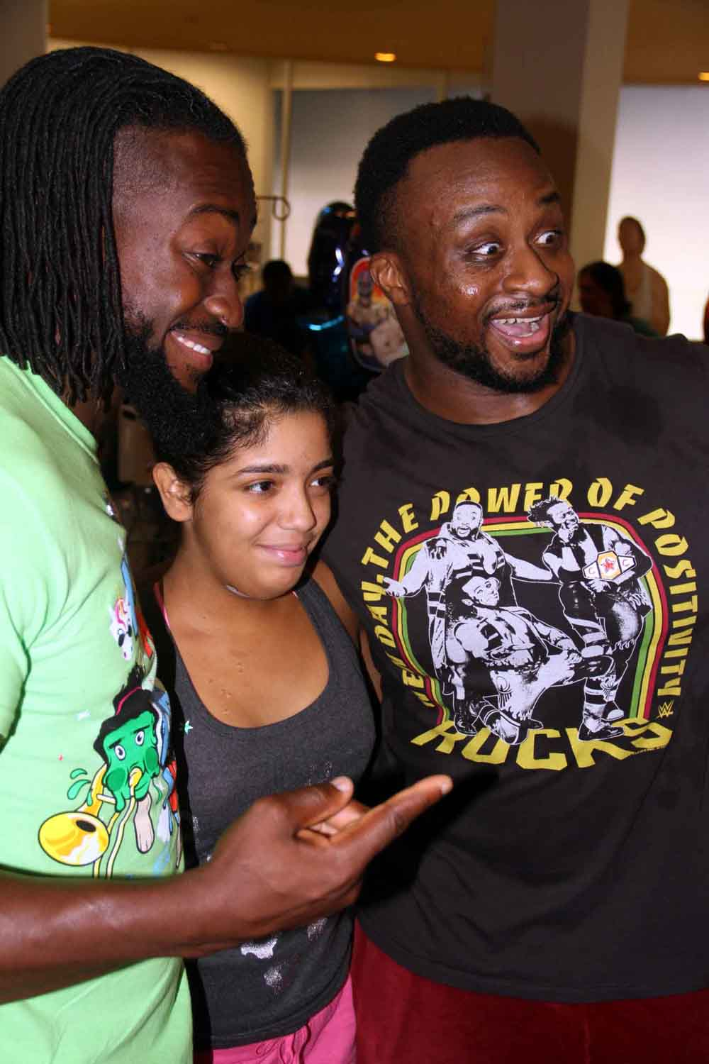 "Jhenlyva Vargas, 17, of Westchester meets WWE stars Kofi Kingston AKA ""The New Day (left) and Big E (right) during a visit to The Children's Hospital at Montefiore.--Photo by David Greene"