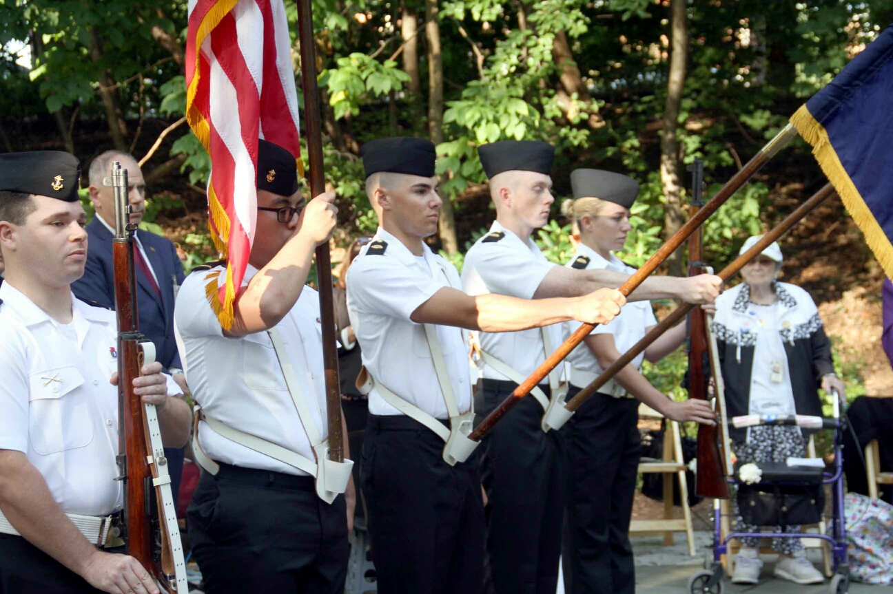 Young members of the SUNY Maritime College Color Guard stand at attention during a moving tribute at Jacobi Hospital.--Photo by David Greene