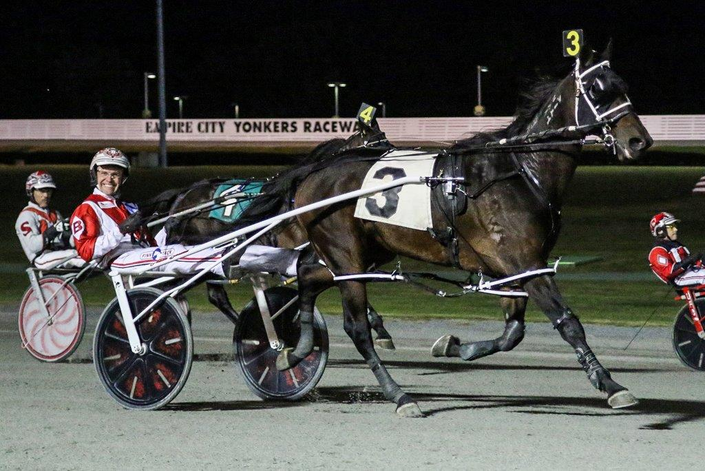 Yonkers Raceway saw Hugh Hefner 'come alive', as Hugh Hefner N., a nine year old pacer, won the seventh race of the night, September 28. Driver Jason Bartlett smiled in amazement. Photo credit: Gabriela Trmal
