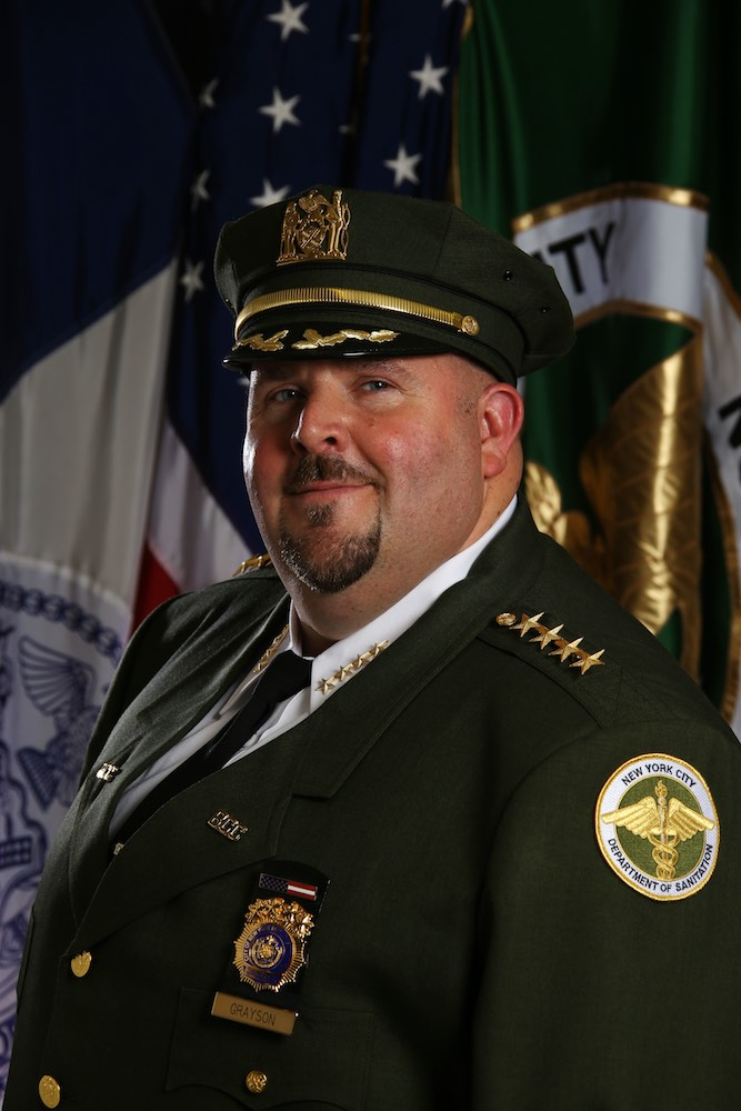 nyc sanitation commissioner names chief edward grayson as