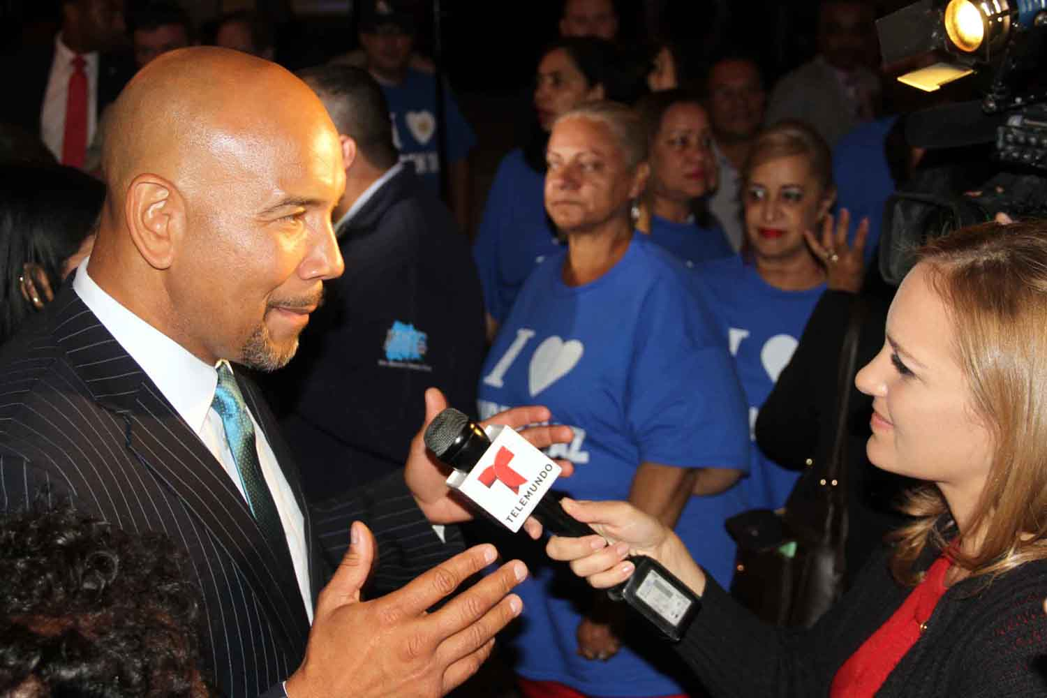 Borough President Ruben Diaz, Jr., gives a television interview during celebration at Maestro's Caterers in Morris Park.--Photo by David Greene