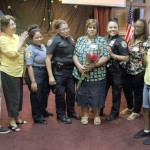Members of the church and local police officers recognize members of the summer school program at the Foxhurst church.--Photo by David Greene
