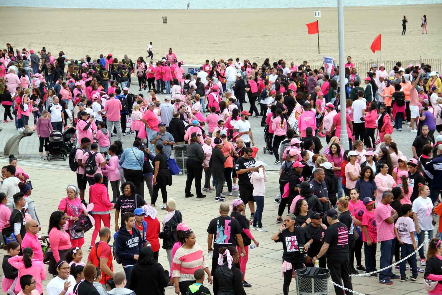 A crowd gathers on Orchard Beach at the start of the annual walk.--Photo by David Greene