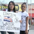 A mother and daughter in Bedford Park seek food and water donations along Webster Avenue for hurricane victims in Puerto Rico and earth quake victims in Mexico.--Photo by David Greene