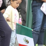 A child holds an Italian flag at the annual Bronx Columbus Day Parade along Morris Park Avenue.--Photo by David Greene