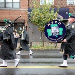 Members of the NYPD Emerald Society perform for the crowd during the annual parade.--Photo by David Greene