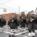 Members of the NYPD Emerald Society march in sync during the Morris Park Columbus Day parade.--Photo by David Greene