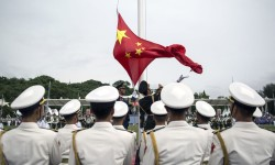 The Peoples Liberation Army PLA soldiers participate in a flag raising ceremony during an open day at the PLA  Navy base in Hong Kong. File: mil.cnr.cn