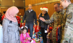 Bronx Borough President Ruben Diaz Jr. greets the families of veterans and active military members, as part of the Wildlife Conservation Society's Bronx Zoo Toy Giveaway for the children of Veterans and Active Military Members event.