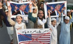 Pakistani demonstrators protest US aid cuts in Lahore -  Image processed by CodeCarvings Piczard   http://piczard.com   http://codecarvings.com