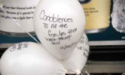 A balloon at the growing memorial tells the story of grief along Prospect Avenue in Belmont.--Photo by David Greene