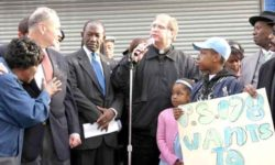 Father Richard Gorman (center) at an Anti-violence rally with Senator Charles Schumer and former Councilman Larry Seabrook, on White Plains Road on November 15, 2009.--Photo by David Greene