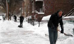 Residents clear out the snow along Paulding Avenue.--Photo by David Greene