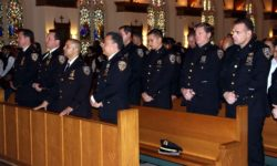 "Nearly 40 NYPD police officers attended the annual ""Blue"" mass at St. Philip Neri Church in Bedford Park.--Photo by David Greene"