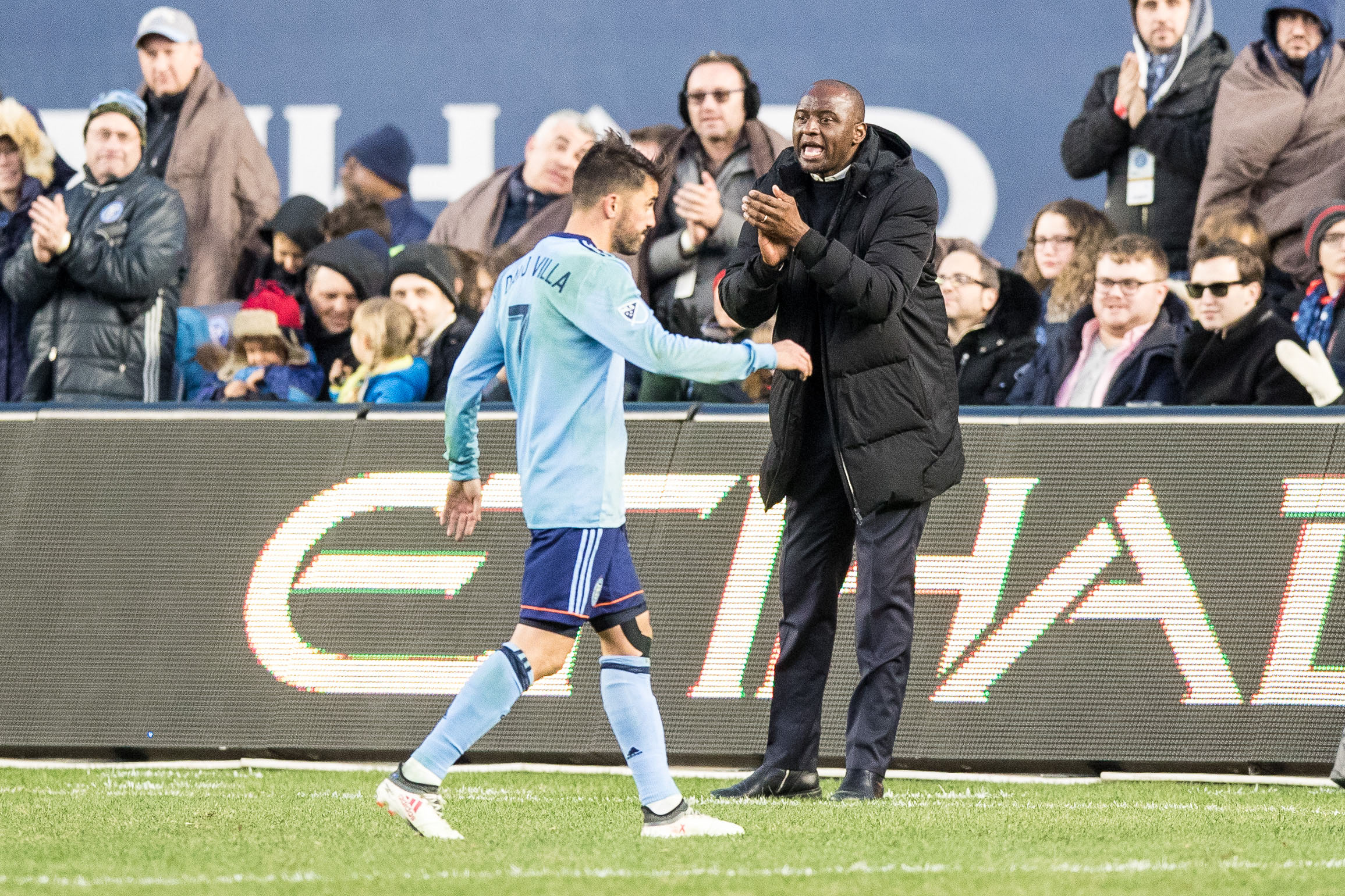 Mar 11, 2018; New York, NY, USA; New York City head coach Patrick Vieira  claps as forward David Villa (7) subs out against the Los Angeles Galaxy during the second half at Yankee Stadium. Mandatory Credit: Vincent Carchietta-USA TODAY Sports