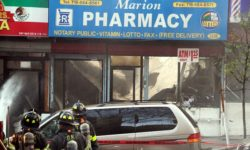 Firefighters continue to fight the blaze shortly after the roof of the Marion Pharmacy collapsed.--Photo by David Greene