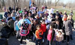 Dozens of children and their parents celebrate Easter in Soundview Park.--Photo by David Greene
