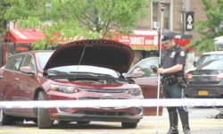 A highway patrolman documents the hit-and-run crash that injured 5 people on the Grand Concourse.--Photo by David Greene