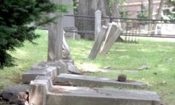 Fallen headstones and headstones ready to fall as the West Farms Soldier Cemetery has been neglected for years.--Photo by David Greene