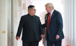 U.S. President Donald Trump walks with North Korean leader Kim Jong Un at the Capella Hotel on Sentosa island in Singapore in this picture released on June 12, 2018 by North Korea's Korean Central News Agency. KCNA