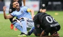 Sep 8, 2018; New York, NY, USA; New York City forward David Villa (7) reacts after colliding with with D.C. United defender Jalen Robinson (20) for a high ball during the first half at Yankee Stadium. Mandatory Credit: Vincent Carchietta-USA TODAY Sports