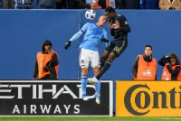 Oct 28, 2018; New York, NY, USA; Philadelphia Union forward Cory Burke (19) attempts a header defended by New York City defender Ben Sweat (2) during the first half at Yankee Stadium. Mandatory Credit: Dennis Schneidler-USA TODAY Sports