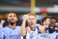 Oct 31, 2018; Bronx, NY, USA; New York City defender Alexander Callens (6) and defender Anton Tinnerholm (3) and midfielder Yangel Herrera (30) ceelbatrets after goal during the second half against the Philadelphia Union at Yankee Stadium. Mandatory Credit: Vincent Carchietta-USA TODAY Sports