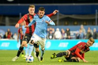 Nov 4, 2018; New York, NY, USA; New York City FC forward David Villa (7) attempts dribbles past Atlanta United defender Julian Gressel (24) during the second half at Yankee Stadium. Mandatory Credit: Dennis Schneidler-USA TODAY Sports
