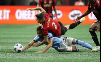 Nov 11, 2018; Atlanta, GA, USA; Atlanta United defender Franco Escobar (2) and New York City midfielder Yangel Herrera (30) get tangled in the first half in the Eastern Conference semifinal at Mercedes-Benz Stadium. Mandatory Credit: Jason Getz-USA TODAY Sports