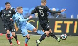 Mar 10, 2019; New York, NY, USA; New York City FC midfielder Alexander Ring (8) collides with D.C. United defender Frederic Brillant (13) as they fight for the ball during the second half at Yankee Stadium. Mandatory Credit: Brad Penner-USA TODAY Sports