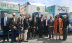 NY AG James and others stand in front of some of the new electric box trucks. Courtesy: Robert Press