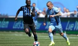 Apr 6, 2019; New York, NY, USA; New York City FC midfielder Alexandru Mitrita (28) plays the ball against Montreal Impact midfielder Micheal Azira (32) during the first half at Yankee Stadium. Mandatory Credit: Brad Penner-USA TODAY Sports