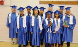 2019 Graduation Group Photo  New York Institute for Special Education (NYISE) graduating students eagerly pose in their caps and gowns before a commencement ceremony celebrating their success on Wednesday, June 19. Proud NYISE middle and high school students, who are visually impaired or emotionally challenged, received their diplomas during the ceremony. (Photo Credit: New York Institute for Special Education)