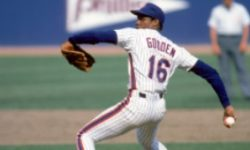 "FLUSHING, NY - 1984: Dwight ""Doc"" Gooden #16 of the New York Mets pitches during a 1984 season game at Shea Stadium in Flushing, New York. (Photo by Rich Pilling/MLB Photos via Getty Images)"