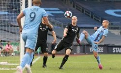 Jul 26, 2019; New York, NY, USA; Sporting Kansas City defender Botond Barath (2) and New York City FC midfielder Alexandru Mitrita (28) battles for the ball during the first half at Yankee Stadium. Mandatory Credit: Vincent Carchietta-USA TODAY Sports