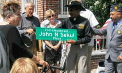 The family of John N. Sekul is given a second street sign to have by Councilman Ruben Diaz Sr.