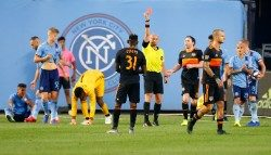 Aug 8, 2019; New York, NY, USA; Houston Dynamo forward Romell Quioto (31) receives a red card during the first half against the New York City FC at Yankee Stadium. Mandatory Credit: Noah K. Murray-USA TODAY Sports