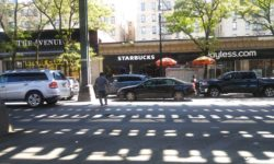 Starbucks is in business, but the stores on both sides are closed.