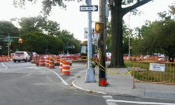 The sidewalk is closed, idle construction equipment sits on Williamsbridge Road blocking lanes during the weekend.