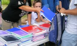 Assemblywoman Fernandez helped the PPNA load the back packs as children walked by.