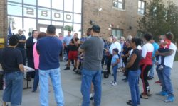 The community residents gathered around Egidio Sementilli to hear the latest news from him about the proposed drug treatment center in their neighborhood, and across the street from a school.