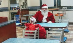 Santa relaxes in White Castle across the street after downing some Belly Bombers.