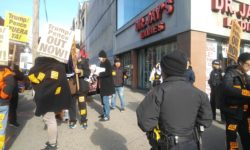 The dozen or so protesters at the corner of Fordham Road and Valentine Avenue.